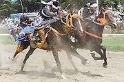 Minami-Soma, Fukushima prefecture, July 25 2015 - Sunday race of Nomaoi, a festival of samurai riding horses.<br /> The Soma nomaoi is said to be a 1000-year-old traditional festival. It was held in 2011, a few months after the nuclear disaster, but only a few local horses were available.