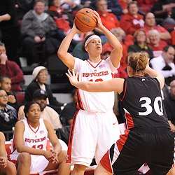 Feb 24, 2009; Piscataway, NJ, USA; Rutgers forward April Sykes (12) controls the ball during the second half of Rutgers' 71-52 victory over Cincinnati at the Louis Brown Athletic Center.