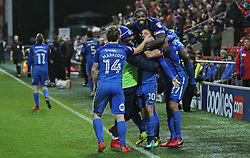 Danny Lloyd of Peterborough United is mobbed by team-mates including Anthony Grant (top) after scoring the winning goal - Mandatory by-line: Joe Dent/JMP - 17/12/2017 - FOOTBALL - Highbury Stadium - Fleetwood, England - Fleetwood Town v Peterborough United - Sky Bet League One