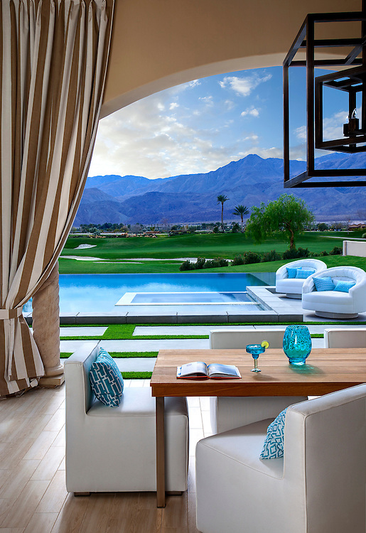 Rear patio and view of pool, spa, desert mountains and golf course of a Contemporary Modern home in La Quinta, CA. Andalusia Country Club