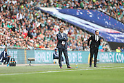 AFC Wimbledon manager Neal Ardley and Derek Adams during the Sky Bet League 2 play off final match between AFC Wimbledon and Plymouth Argyle at Wembley Stadium, London, England on 30 May 2016.
