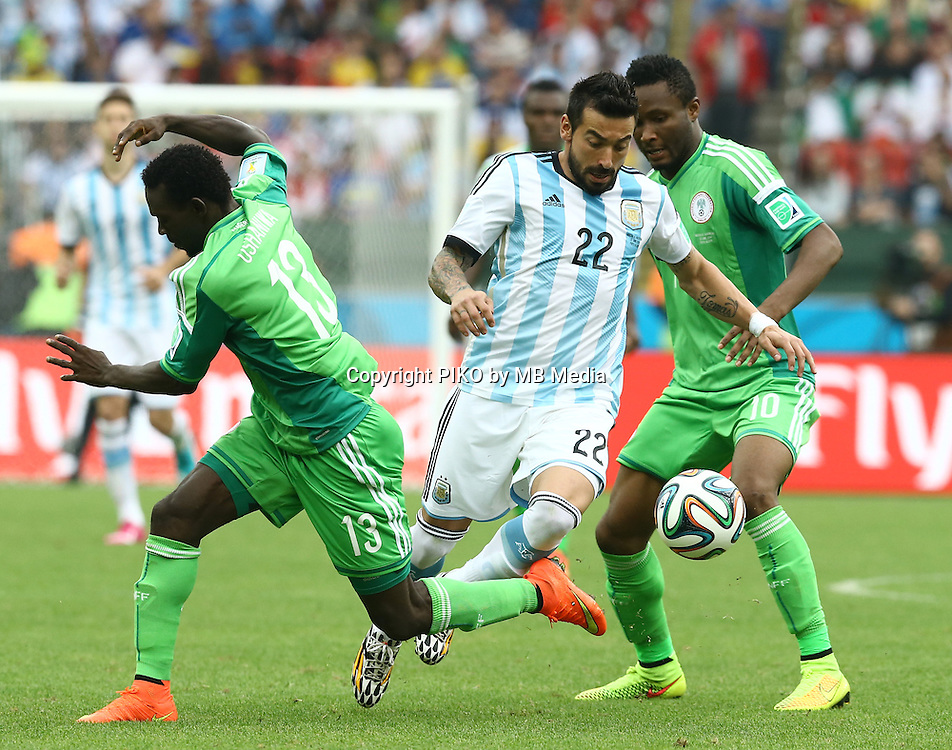 Fifa Soccer World Cup - Brazil 2014 - <br /> NIGERIA  (NGA) Vs. ARGENTINA (ARG) - Group F - Estadio Beira-RioPorto Alegre - Brazil (BRA) - June 25, 2014 <br /> Here Argentine player Ezequiel Lavezzi between Nigeria players Juwon OSHANIWA (L) and John Obi MIKEL (R)  .<br /> &copy; PikoPress