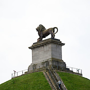 Tourists climb to the top of the Lion's Mound (Butte du Lion), an artificial hill built on the battlefield of Waterloo to commemorate the location where William II of the Netherlands was injured during the battle. The hill is situated on a spot along the line where the Allied army under the Duke of Wellington's command took up positions during the Battle of Waterloo.