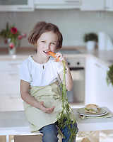 Young girl eating carrot