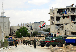 DOUMA, April 14, 2018  Russian military vehicles enter the Douma district in the eastern countryside of the capital Damascus of Syria, on April 14, 2018. Around 93 buses with hundreds of Islam Army militants and their families onboard prepared on Friday to evacuate Damascus' eastern Douma district, amid reports of the arrival of the chemical weapons investigators on Saturday to look into allegations of toxic gas use in Douma.  zjl) (Credit Image: © Ammar Safarjalani/Xinhua via ZUMA Wire)