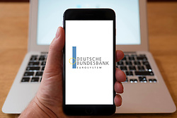 Using iPhone smart phone to display website logo of Deutsche Bundesbank, central Bank of Germany