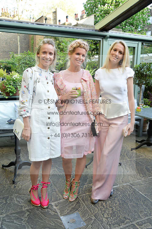 Left to right, MARTHA WARD, COUNTESS ALEXANDRA TOLSTOY and SOFIA BLUNT at a party to celebrate 'A Year In The Garden' celebrating the first year of The Ivy Chelsea Garden, 197 King's Road, London on 16th May 2016.