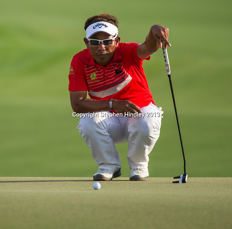 Thongchai Jaidee of Thailand studies the green before his putt on the 18th, during the second round of the DP World Tour Championship held at the Jumeirah Golf Estates in Dubai, United Arab Emirates, on Friday, November 15, 2013.  Photo by: Stephen Hindley/SPORTDXB