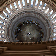 Visitors pay their respects as the remains of Sen. Daniel Inouye (D-HI) lay in state in the Rotunda of the Capitol Building on Dec. 20th, 2012 in Washington.