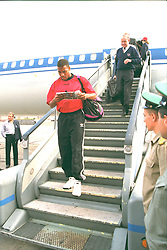 VLADIKAVKAZ, RUSSIA - Monday, September 11, 1995: Liverpool's captain John Barnes steps off the Aeroflot plane at Vladikavkaz airport as the team arrive in Russia ahead of the UEFA Cup 1st Round 1st Leg match against FC Alania Spartak Vladikavkaz. (Photo by David Rawcliffe/Propaganda)