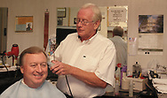 Ralph Williams cuts the hair of long-time customer Rick Williams at Scotty's Barber Shop, in Springboro on Wednesday, June 27th.  Ralph has been cutting Rick's hair for 46 years.