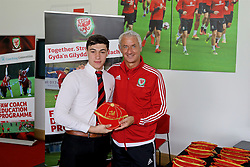 NEWPORT, WALES - Sunday, May 28, 2017: Jake Van Schie receives a cap from Elite Performance Director Ian Rush for participation during day three of the Football Association of Wales' National Coaches Conference 2017 at Dragon Park. (Pic by Mark Roberts/Propaganda)