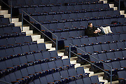 A fan enjoys popcorn before the start of a game between the Amerks and the Springfield Falcons at the Blue Cross Arena in Rochester on Friday, March 4, 2016.