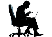 one caucasian business man computer computing pointing sitting in armchair silhouette Full length in studio isolated on white background