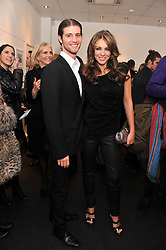 ANTHONY SOUZA and ELIZABETH HURLEY at a private view of photographs by Anthony Souza held at The Little Black Gallery, 13A Park Walk, London SW10 on 13th December 2011.