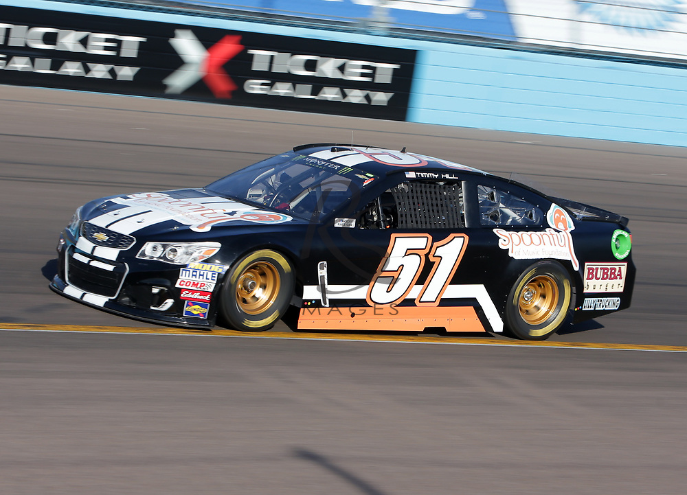 Timmy Hill qualifies for Sunday's NASCAR Cup Series auto race on Friday, March 17, 2017, in Avondale, Ariz.  (AP Photo/Rick Scuteri)
