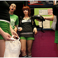 Hope Renee, top left, and Jenn Angele watch as Celeste Lajoine, and Megan Hucks, members of the Greenville Rollergirls sort out safety pads after practice at Galaxy Sports in Kinston, N.C.