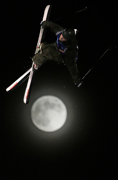 TJ Schiller, of Canada, soars above a full moon at San Francisco's AT&T Park during the 2nd annual Icer Big Air competition.  Schiller, who took third in last year's contest, came in first.
