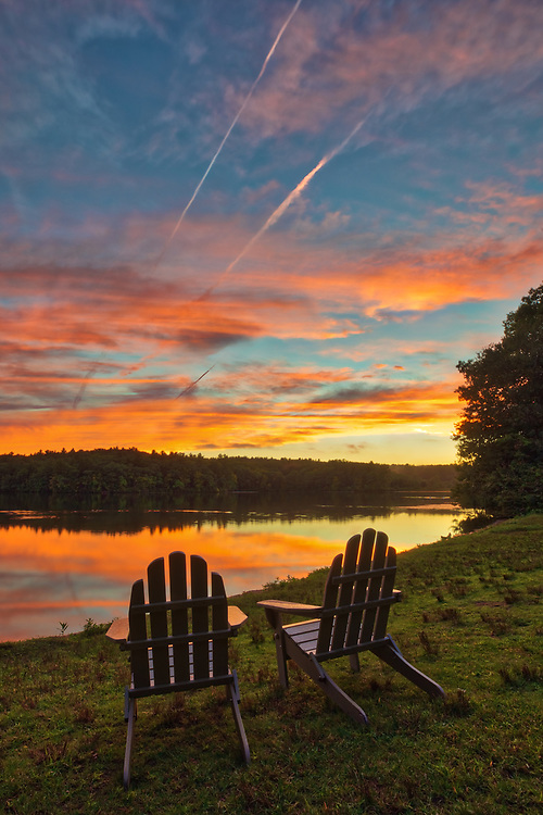 Massachusetts sunset photography with lawn chairs providing front row seating to a Mother Nature spectacle at Lake Waban in Wellesley Massachusetts. This Massachusetts lake with Wellesley College nearby are inspiring and make for a beautiful New England nature photography location to visit and to get lost with a camera.<br /> <br /> Lake Waban sunset photos are available as museum quality photo, canvas, acrylic, wood or metal prints. Wall art prints may be framed and matted to the individual liking and wall art décor project needs:<br /> <br /> https://juergen-roth.pixels.com/featured/natural-new-england-juergen-roth.html<br /> <br /> Good light and happy photo making!<br /> <br /> My best,<br /> <br /> Juergen<br /> Photo Prints & Licensing: http://www.rothgalleries.com<br /> Photo Blog: http://whereintheworldisjuergen.blogspot.com<br /> Instagram: https://www.instagram.com/rothgalleries<br /> Twitter: https://twitter.com/naturefineart<br /> Facebook: https://www.facebook.com