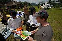 Foja Mountains RAP expedition members Nev Kemp and Kris Helgen explain the desired drop location to the helicopter pilots after they arrive at Kwerba Village.