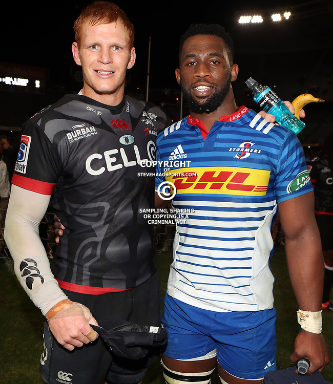DURBAN, SOUTH AFRICA - MAY 27: Philip van der Walt (captain) of the Cell C Sharks with Siya Kolisi (captain) of the DHL Stormers during the Super Rugby match between Cell C Sharks and DHL Stormers at Growthpoint Kings Park on May 27, 2017 in Durban, South Africa. (Photo by Steve Haag/Gallo Images)