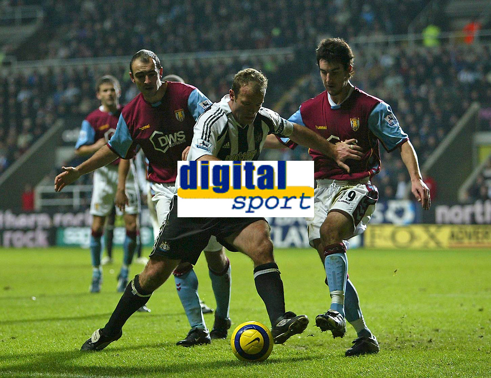 Photo: Andrew Unwin.<br />Newcastle Utd v Aston Villa. The Barclays Premiership.<br />03/12/2005.<br />Newcastle's Alan Shearer (C) finds his way blocked by Aston Villa's Liam Ridgewell (R).