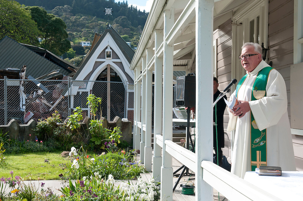 The Reverend Neil Struthers  leads a Farewell and Thanksgiving service in the grounds of Lyttelton Holy Trinity Anglican Church,  built in 1859 an historic place category 1 destroyed in the earthquakes,  October 9, 2011. Credit: SNPA /  David Alexander.