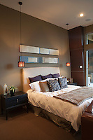 Pendant lights in bedroom with silk furnishings