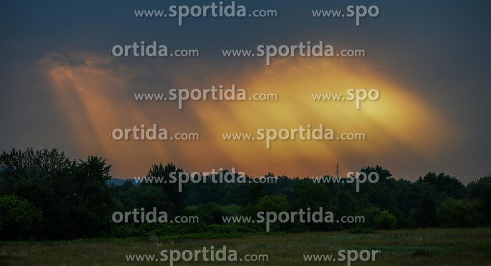 THEMENBILD - Lichteinfall durch dunklen, st&uuml;rmischen und wolkenverhangenen Abendhimmel, Aufgenommen am 9. Juni 2015 in Zagreb, Kroatien // through black and a storm sky opened round of sunlight, above the settlement of Zagreb Podsused Zagreb, Croatia on 2015/06/09. EXPA Pictures &copy; 2015, PhotoCredit: EXPA/ Pixsell/ Marko Prpic<br /> <br /> *****ATTENTION - for AUT, SLO, SUI, SWE, ITA, FRA only*****