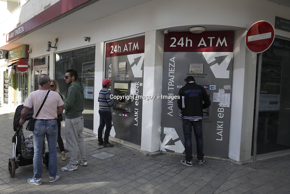 People withdraw money from Atm in Nicosia, Cyprus, March 19,2013. Photo by Imago / i-Images...UK ONLY.Contact..
