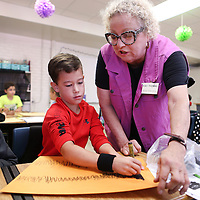 Adam Robison | BUY AT PHOTOS.DJOURNAL.COM<br /> Kay Thomas, a visual arts teacher, helps Braden Miller, 9, a fourth grader at Pierce Street Elementary School, with his arts intergration project during her time at the school to teach arts intergration lessons Tuesday morning in Tupelo.