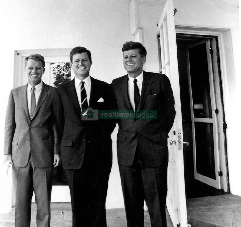 John F. Kennedy, the nation's 35th President, would have turned 100 years old on May 29, 2017. With the centennial anniversary of John F. Kennedy's birth, the former president's legacy is being celebrated across the nation. PICTURED: Aug. 28, 1963 - Washington, District of Columbia, U.S. - President JOHN F KENNEDY (L) with brothers, Attorney General ROBERT F KENNEDY (R) and TED KENNEDY outside the Oval Office at the White House. (Credit Image: © JFK Collection/Kennedy Library/ZUMAPRESS.com)