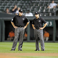 25 September 2007:  Umpires Gary Cedestrom (L) and Jim Reynolds (R) talk between innings during the game between the Toronto Blue Jays and the Baltimore Orioles.  The Blue Jays defeated the Orioles 11-4 at Camden Yards in Baltimore, MD.  ****For Editorial Use Only****