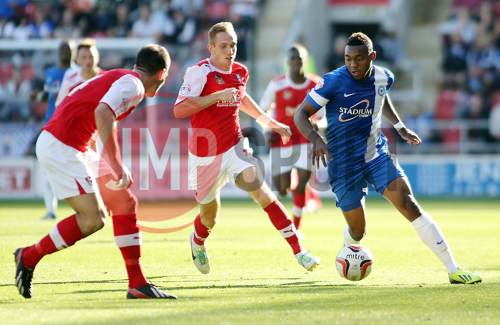 Peterborough United's Britt Assombalonga in action with Rotherham United's Robert Milsom - Photo mandatory by-line: Joe Dent/JMP - Tel: Mobile: 07966 386802 28/09/2013 - SPORT - FOOTBALL - New York Stadium - Rotherham - Rotherham United V Peterborough United - Sky Bet One