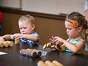 27 JUNE 2019 - CENTRAL CITY, IOWA: ALIVIA HOOVER, 4, watches her stack of sandwich cream cookies collapse during the cookie stacking contest at the Linn County Fair. Summer is county fair season in Iowa. Most of Iowa's 99 counties host their county fairs before the Iowa State Fair, August 8-18 this year. The Linn County Fair runs June 26 - 30. The first county fair in Linn County was in 1855. The fair provides opportunities for 4-H members, FFA members and the youth of Linn County to showcase their accomplishments and talents and provide activities, entertainment and learning opportunities to the diverse citizens of Linn County and guests.       PHOTO BY JACK KURTZ