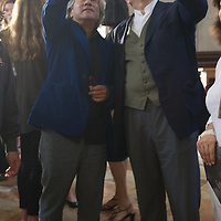 "VENICE, ITALY - MAY 31:  Artist Anish Kapoor (L) points at the column of smoke of his installation ""Ascension"" during the press preview at Basilica di San Giorgio on May 31, 2011 in Venice, Italy. ""Ascension"" is an installation that cosnist of a column of white smoke rising from a circular base placed at the intersection between the transet and the nave of Basilica of San Giorgio Maggiore"