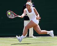 Wimbledon Championships 2012 AELTC,London,.ITF Grand Slam Tennis Tournament,.Sabine Lisicki (GER), Aktion,,Einzelbild,Ganzkoerper,Querformat,.