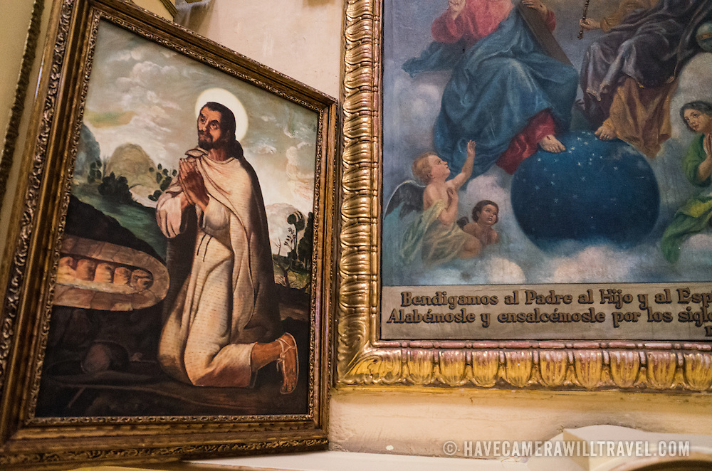 Paintings on display at the the Iglesia de Santa Ines (Church of Saint Agnes) in the historic Centro Historico district of downtown Mexico City, Mexico.