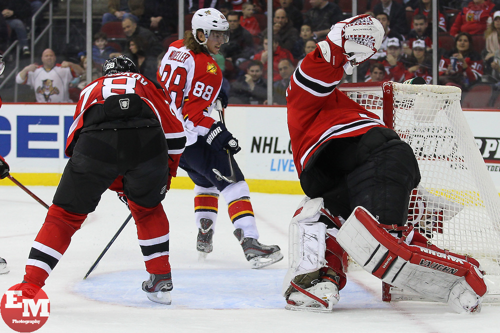 Mar 23, 2013; Newark, NJ, USA; Florida Panthers right wing Peter Mueller (88) scores a goal on New Jersey Devils goalie Martin Brodeur (30) during the second period at the Prudential Center.