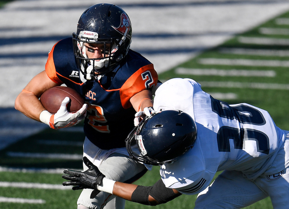 Orange Coast College's Joey Hunt, left, pushes past Fullerton College's Tim Gordon during the Orange Coast College vs. Fullerton College football game at Orange Coast College in California on Saturday.