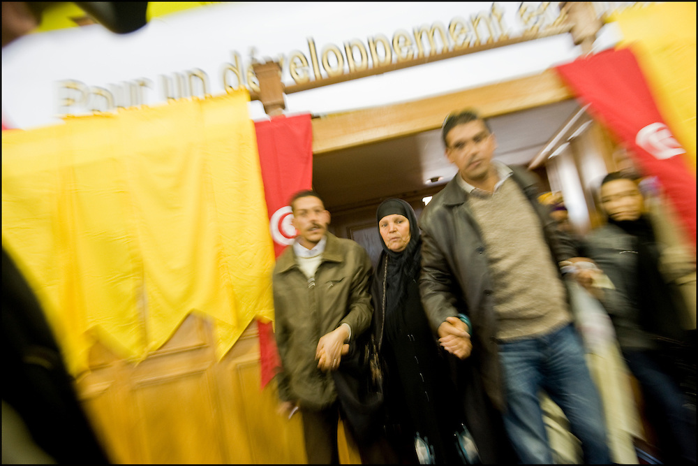 The mother of Mohamed Bouazizi is introduce by Ahmed Nejib Chebbi  at the start of the first political meeting of the PDP (Left progressive Democrats) since Ben Ali's escape the country, the meeting takes place in Olympic stadium of El Menzah in the presence of the rapper El Général, of the mom of Mohamed Bouazizi, martyr of the revolution and the leader of the party for the next presidential elections Ahmed Nejib Chebbi, current Minister of the regional and local development in the government of transition, Tunis on January 29, 2011. Copyright Benjamin Girette