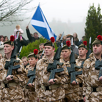 The Black Watch Homecoming Parade, Aberfeldy....10.12.09<br /> A Saltire flies above the heads of soldiers of the Black Watch as they parade through Aberfeldy on their return from Afghanistan.......Aberfeldy is where the 'Companies' of men were mustered in 1667, the dark tartans that the men wore to distinguish them from the 'Red Soldiers' led them to becoming known as 'Freiceadan Dubh' or 'The Black Watch'<br /> Picture by Graeme Hart.<br /> Copyright Perthshire Picture Agency<br /> Tel: 01738 623350  Mobile: 07990 594431