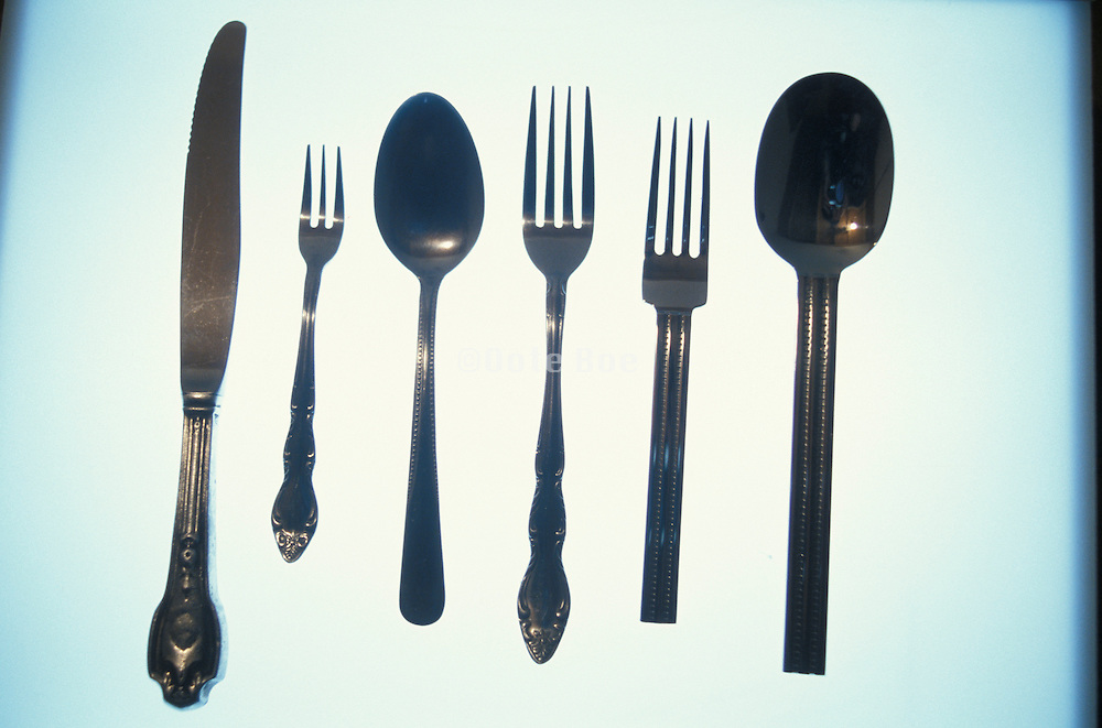 Dining utensils on an illuminated surface