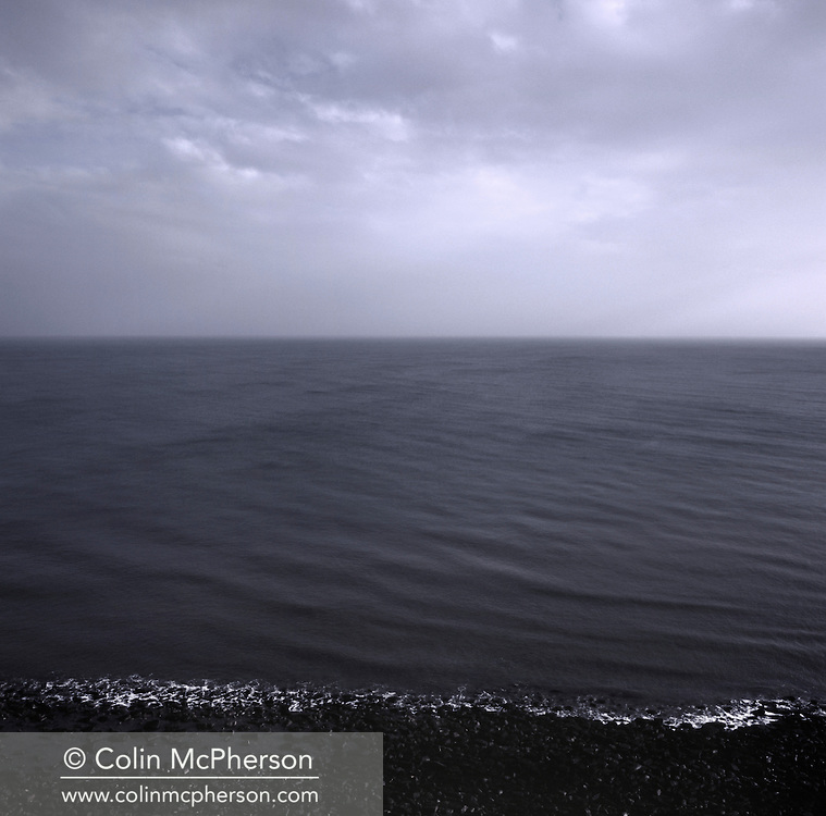 'Inshore waters, 2014' from 'A Fine Line - Exploring Scotland's Border with England' by Colin McPherson.<br /> <br /> The North Sea, looking east from the border. In 1999 by order of the Westminster parliament in London, around 6000 square miles was unilaterally transferred from Scottish ownership to become part of England's territorial waters.<br /> <br /> The project was a one-year exploration of the border between the two historic nations, as seen from the Scottish side of the frontier.<br /> <br /> Colin McPherson is a photographer and visual artist based in north west England. In 2012 he was one of the founding members of Document Scotland, a collective of four Scottish documentary photographers brought together by a common vision to witness and photograph the important and diverse stories within Scotland at one of the most important times in our nation's history.<br /> <br /> 'A Fine Line' will be shown for the first time in public at Impressions Gallery, Bradford, from July 1 until September 27, 2014 to coincide with the Scottish Independence referendum.