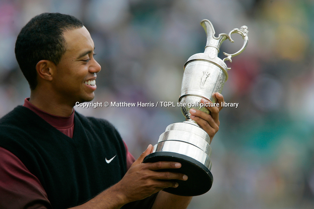 Tiger WOODS (USA) is all smiles holding the famous claret jug trophy during fourth round The Open Championship 2005,St Andrews Old Course,St Andrews,Fife,Scotland.