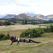 Jess Poplawski riding Arapaho in action at the water jump during the Cross Country event at the Wakatipu One Day Horse Trials at the Pony Club grounds,  Queenstown, Otago, New Zealand. 15th January 2012. Photo Tim Clayton