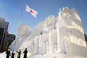 Members of Japan's Self Defense Forces hoist the national flag during the Sapporo Snow and Ice Festival in Sapporo City, northern Japan. Around 2 million people visit the city to see the hundreds of hand-crafted snow and ice sculptures that have graced the Sapporo Snow and Ice Festival since its inception in 1950.