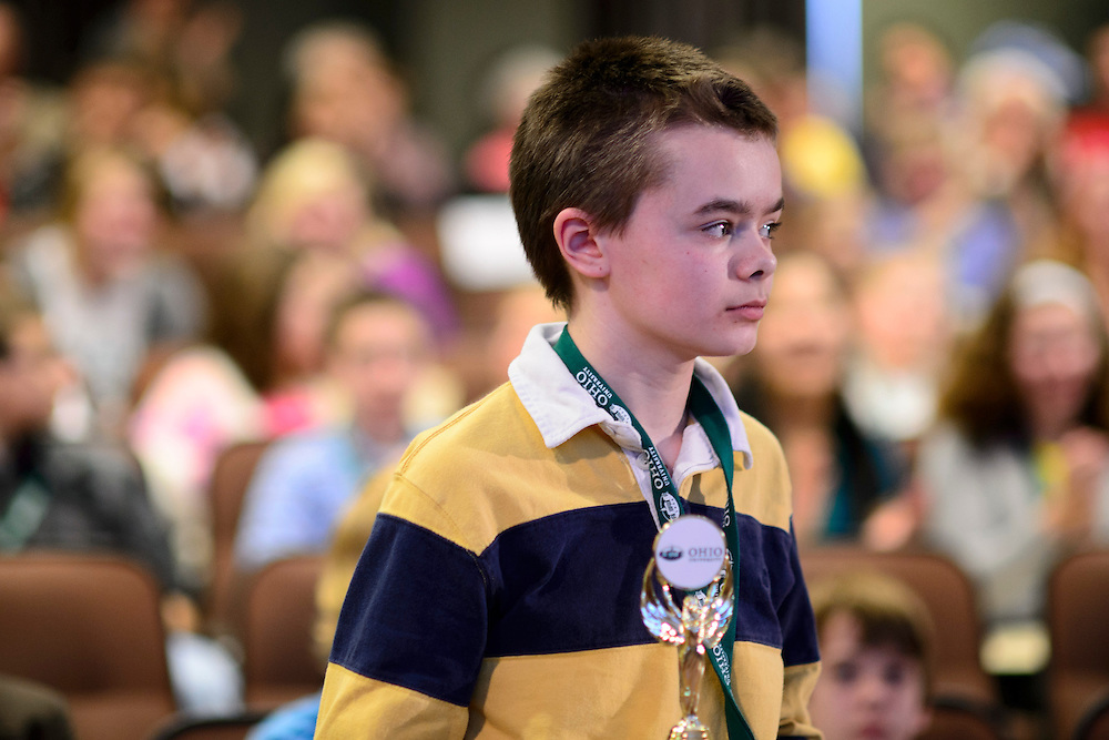 Matthew Pitcock of Maysville Middle School located in Zanesville, OH, holds his trophy after being named the Southeastern Ohio Regional Spelling Bee champion Saturday, March 16, 2013. The Regional Spelling Bee was sponsored by Ohio University's Scripps College of Communication and held in Margaret M. Walter Hall on OU's main campus.