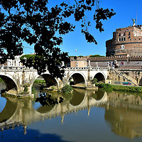 Ponte Sant&rsquo;Angelo and Castel Sant&rsquo;Angelo in Rome, Italy <br /> When you reach this point on your river walk, stop a moment to fully appreciate the beauty of the Ponte Sant&rsquo;Angelo. This five arch marble bridge was commissioned by Emperor Hadrian early in the second century to connect the ancient city of Rome to his mausoleum on the right. It is called Castel Sant&rsquo;Angelo or the Castle of the Holy Angel. This bridge is not only one of the most stunning in Roma but also all of Europe.