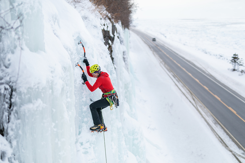 Nathalie Forton climbing road side ice in Gaspesie, Quebec